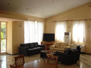 Χώρος καθιστικού στο Cybele Guest Accommodation