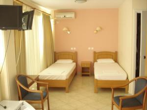 Ένα ή περισσότερα κρεβάτια σε δωμάτιο στο Cybele Guest Accommodation