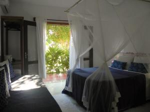 A bed or beds in a room at Ouro Sobre Azul Apart Hotel