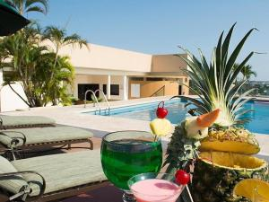 The swimming pool at or near Tabasco Inn