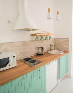 Кухня или мини-кухня в Smart Apart