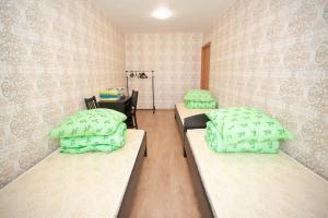 Кровать или кровати в номере Апартаменты на Ленинградской 63