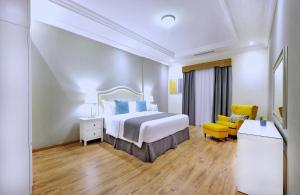 Cama ou camas em um quarto em Spectrums Residence Managed by The Ascott Limited