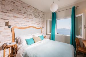 Ένα ή περισσότερα κρεβάτια σε δωμάτιο στο Ikion Eco Boutique Hotel