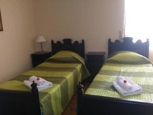 Letto o letti in una camera di Mamma Mia Guest House