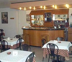 A restaurant or other place to eat at Hotel Airone