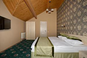 Кровать или кровати в номере Отель Апельсин на Тульской