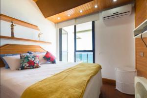 Cama ou camas em um quarto em BarraBella Apart-Hotel