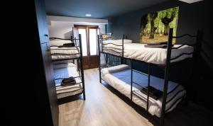 A bunk bed or bunk beds in a room at Koikili Aterpetxea