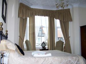 A bed or beds in a room at The Carmen (Adult Only)