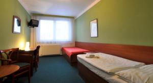 Postel nebo postele na pokoji v ubytování Hotel Krystal