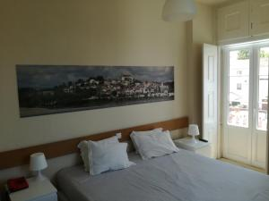 Cama o camas de una habitación en Casa João Chagas Guesthouse, Constância