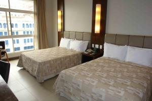 Cama ou camas em um quarto em Parque Balneário Santos by Atlantica Hotels