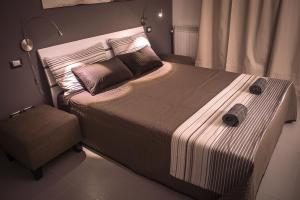 A bed or beds in a room at Barbarisco 5