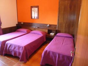Letto o letti in una camera di Hotel Caldora