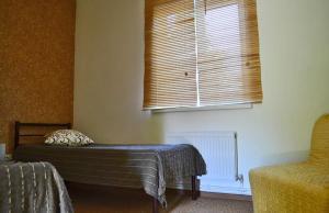 Кровать или кровати в номере Гостевой Дом Сиеста