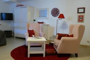 A seating area at Apartment Am Markt 13