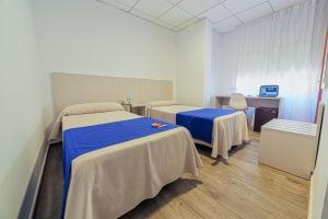 Cama o camas de una habitación en La Perla