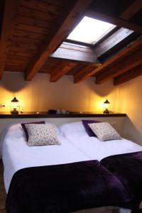 Cama o camas de una habitación en Posada Rural La Piñorra