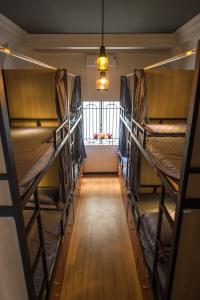 A bunk bed or bunk beds in a room at The Like Hostel & Cafe