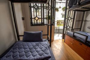 A bed or beds in a room at The Like Hostel & Cafe