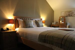 A bed or beds in a room at The Angel at Topcliffe