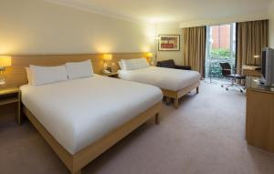 A bed or beds in a room at Hilton Leicester Hotel