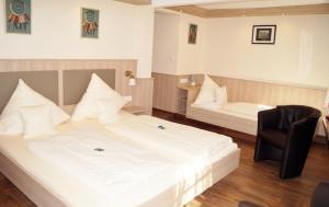 Ein Bett oder Betten in einem Zimmer der Unterkunft Hotel Gute Quelle