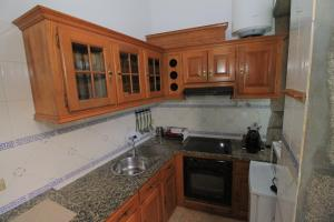 A kitchen or kitchenette at Lima Apartments