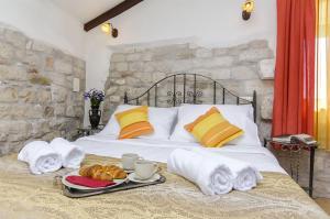 Ein Bett oder Betten in einem Zimmer der Unterkunft Palace Derossi
