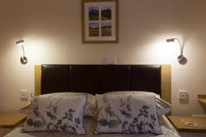 A bed or beds in a room at Cedars Guest House