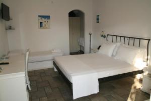 Ένα ή περισσότερα κρεβάτια σε δωμάτιο στο Ξενοδοχείο Αλέξανδρος