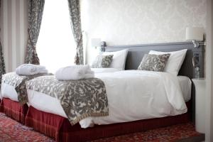 A bed or beds in a room at Mercure Arbat Moscow