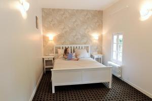 Un ou plusieurs lits dans un hébergement de l'établissement Maison du Loir