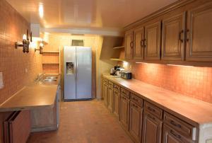 Cuisine ou kitchenette dans l'établissement Maison du Loir