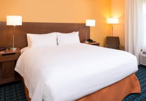 A bed or beds in a room at Fairfield Inn Orlando Airport