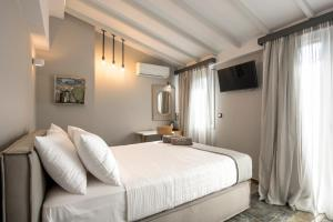 A bed or beds in a room at The Secret Boutique Hotel