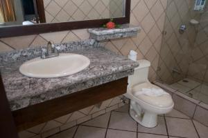 A bathroom at Arenal Volcano Inn