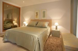 Cama o camas de una habitación en The View – Santo António Villas, Golf & Spa