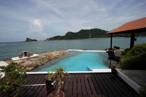 The swimming pool at or near Gem Island Resort & Spa