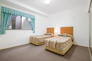 A bed or beds in a room at Rainbow Sea Resort