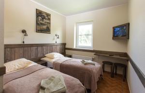 Lova arba lovos apgyvendinimo įstaigoje Sodyba Ignė