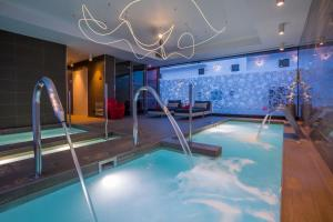 The swimming pool at or near Migjorn Ibiza Suites & Spa