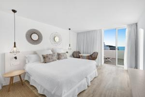 A bed or beds in a room at Barceló Portinatx - Adults Only