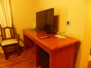 A television and/or entertainment center at Garden House Hotel
