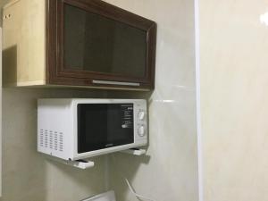 Телевизор и/или развлекательный центр в Apartment Курортная зона