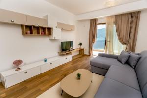 Area soggiorno di Athos apartments