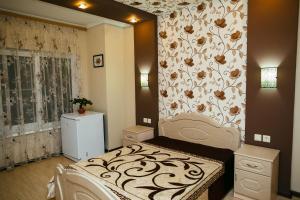Кровать или кровати в номере VItaliya
