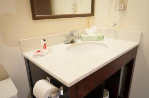 A bathroom at Super 8 by Wyndham Old Saybrook