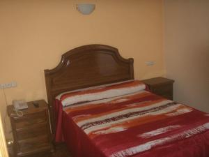 Uma cama ou camas num quarto em Hostal La Nava